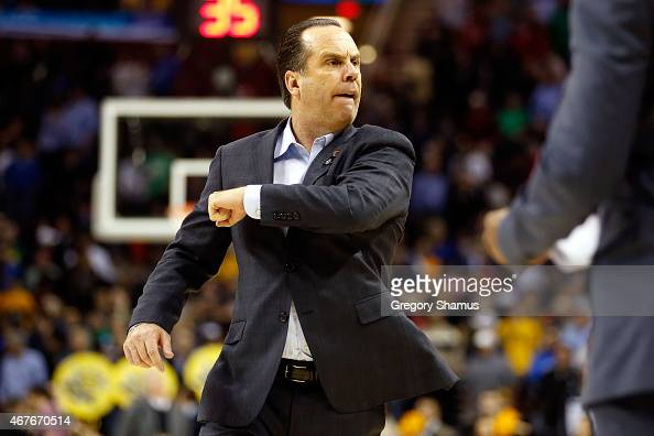 Head coach Mike Brey of the Notre Dame Fighting Irish reacts after defeating the Wichita State Shockers during the Midwest Regional semifinal of the...