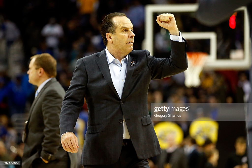 Head coach <a gi-track='captionPersonalityLinkClicked' href=/galleries/search?phrase=Mike+Brey&family=editorial&specificpeople=221188 ng-click='$event.stopPropagation()'>Mike Brey</a> of the Notre Dame Fighting Irish reacts after defeating the Wichita State Shockers during the Midwest Regional semifinal of the 2015 NCAA Men's Basketball Tournament at Quicken Loans Arena on March 26, 2015 in Cleveland, Ohio.