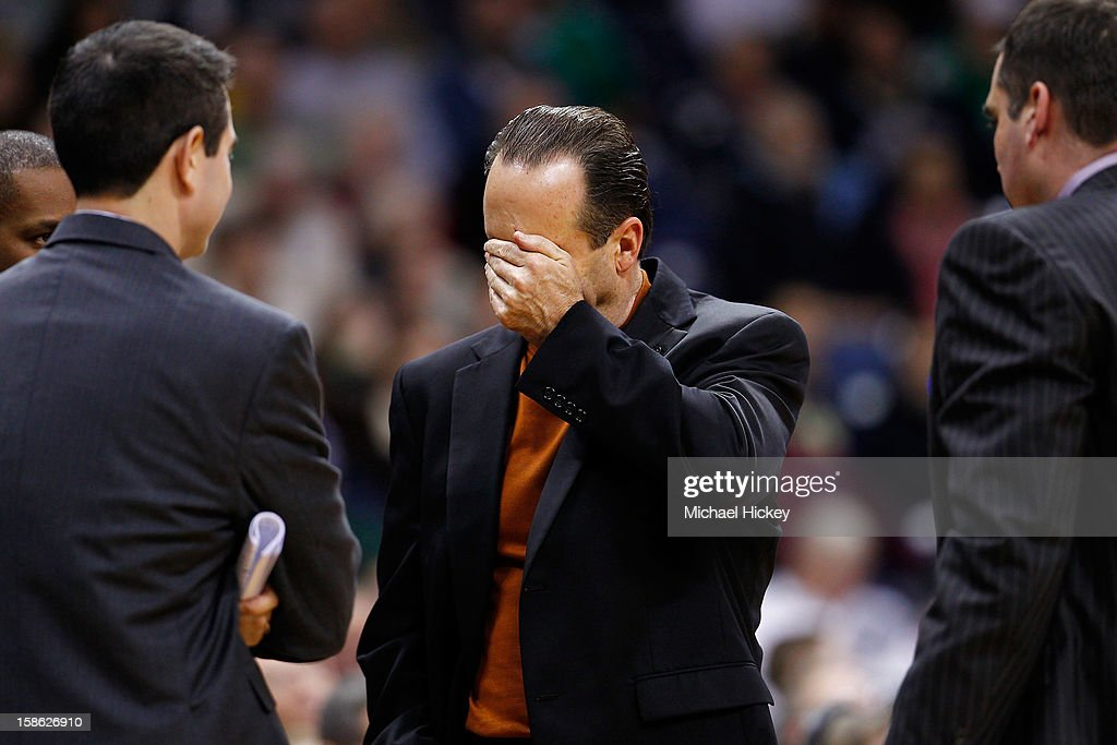 Head coach <a gi-track='captionPersonalityLinkClicked' href=/galleries/search?phrase=Mike+Brey&family=editorial&specificpeople=221188 ng-click='$event.stopPropagation()'>Mike Brey</a> of the Notre Dame Fighting Irish reacts during a timeout against the Niagara Purple Eagles at Purcel Pavilion on December 21, 2012 in South Bend, Indiana.