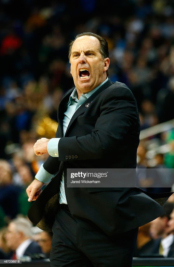 Head coach <a gi-track='captionPersonalityLinkClicked' href=/galleries/search?phrase=Mike+Brey&family=editorial&specificpeople=221188 ng-click='$event.stopPropagation()'>Mike Brey</a> of the Notre Dame Fighting Irish reacts during the second half against the Butler Bulldogs during the third round of the 2015 NCAA Men's Basketball Tournament at Consol Energy Center on March 21, 2015 in Pittsburgh, Pennsylvania.