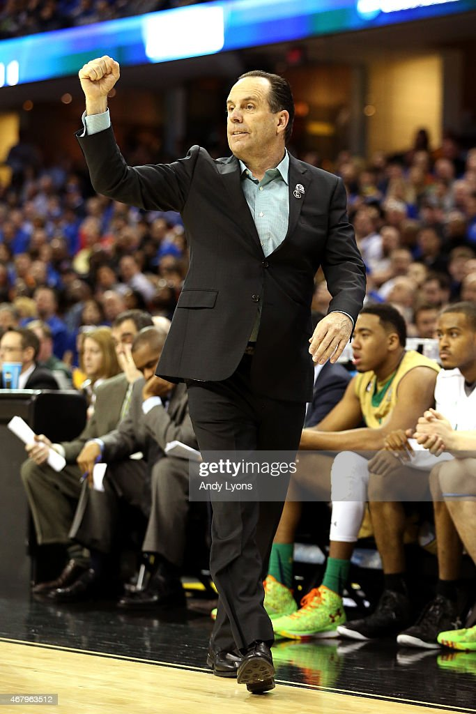 Head coach <a gi-track='captionPersonalityLinkClicked' href=/galleries/search?phrase=Mike+Brey&family=editorial&specificpeople=221188 ng-click='$event.stopPropagation()'>Mike Brey</a> of the Notre Dame Fighting Irish reacts from the bench in the second half against the Kentucky Wildcats during the Midwest Regional Final of the 2015 NCAA Men's Basketball tournament at Quicken Loans Arena on March 28, 2015 in Cleveland, Ohio.