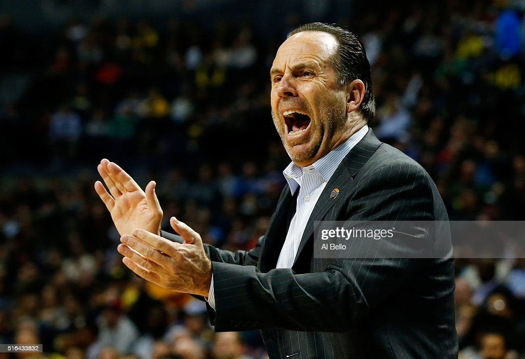 Head coach <a gi-track='captionPersonalityLinkClicked' href=/galleries/search?phrase=Mike+Brey&family=editorial&specificpeople=221188 ng-click='$event.stopPropagation()'>Mike Brey</a> of the Notre Dame Fighting Irish reacts in the first half against the Michigan Wolverines during the first round of the 2016 NCAA Men's Basketball Tournament at Barclays Center on March 18, 2016 in the Brooklyn borough of New York City.