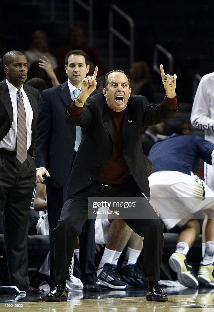 Head coach <a gi-track='captionPersonalityLinkClicked' href=/galleries/search?phrase=Mike+Brey&family=editorial&specificpeople=221188 ng-click='$event.stopPropagation()'>Mike Brey</a> of the Notre Dame Fighting Irish signals to his team during the consolation game of the Coaches Vs. Cancer Classic against the Brigham Young Cougars at the Barclays Center on November 17, 2012 in the Brooklyn borough of New York City.