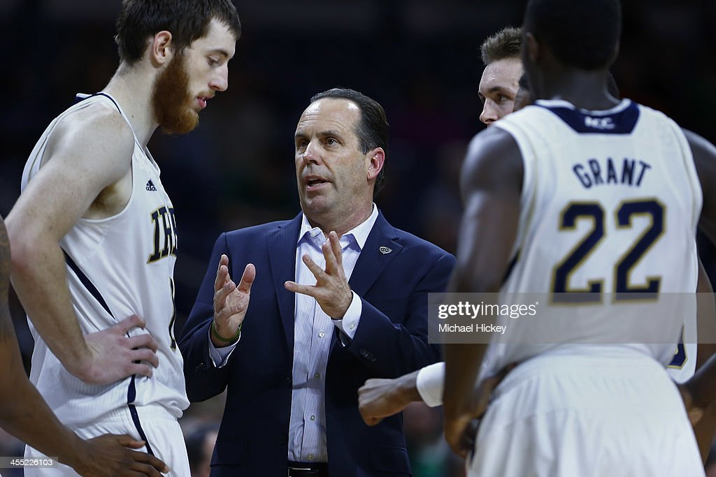 Head coach Mike Brey of the Notre Dame Fighting Irish talks to Garrick Sherman #11 of the Notre Dame Fighting Irish during a timeout in the game against the North Dakota State Bison at Purcel Pavilion on December 11, 2013 in South Bend, Indiana. North Dakota State defeated Notre Dame 73-69.
