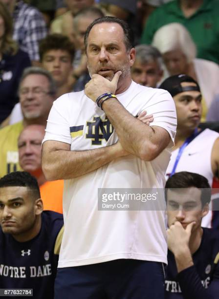 Head coach Mike Brey of the Notre Dame Fighting Irish watches the action during the first half of the game against the Wichita State Shockers at the...