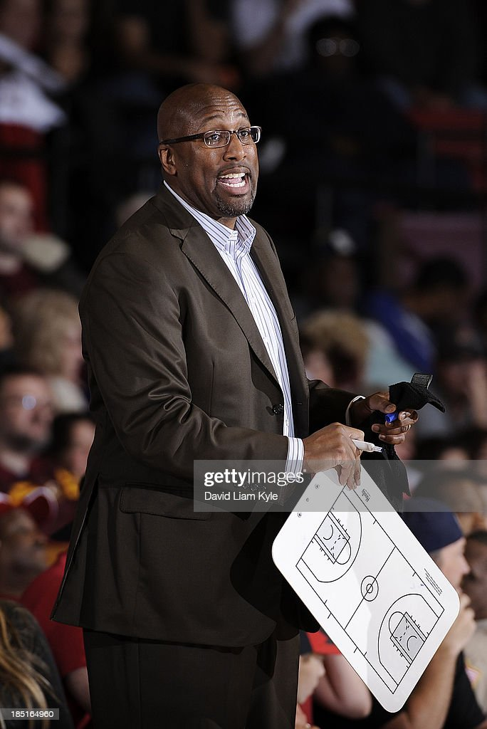 Head coach <a gi-track='captionPersonalityLinkClicked' href=/galleries/search?phrase=Mike+Brown+-+Basketball+Coach+-+Born+1970&family=editorial&specificpeople=2187772 ng-click='$event.stopPropagation()'>Mike Brown</a> of the Cleveland Cavaliers calls out the play during a break in the action against the Charlotte Bobcats at the Canton Memorial Civic Center on October 15, 2013 in Canton, Ohio.