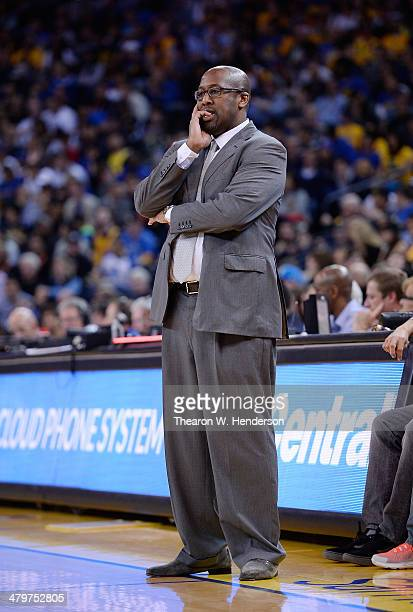 Head Coach Mike Brown of the Cleveland Cavaliers looks on against the Golden State Warriors at ORACLE Arena on March 14 2014 in Oakland California...