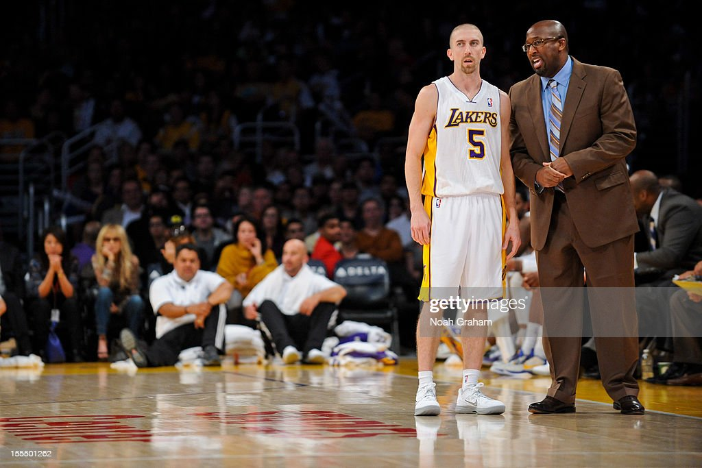 Head Coach Mike Brown of the Los Angeles Lakers speaks to <a gi-track='captionPersonalityLinkClicked' href=/galleries/search?phrase=Steve+Blake+-+Basketball+Player&family=editorial&specificpeople=204474 ng-click='$event.stopPropagation()'>Steve Blake</a> #5 while playing against the Detroit Pistons at Staples Center on November 4, 2012 in Los Angeles, California.