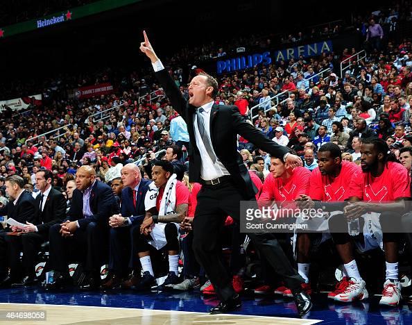 Head Coach Mike Budenholzer of the Atlanta Hawks calls a play against the Orlando Magic on February 27 2015 at Philips Arena in Atlanta Georgia NOTE...