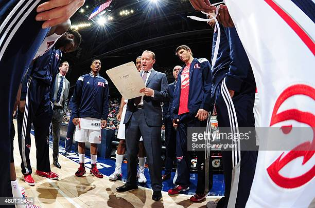 Head Coach Mike Budenholzer of the Atlanta Hawks designs a play against the Denver Nuggets on December 7 2014 at Philips Arena in Atlanta Georgia...
