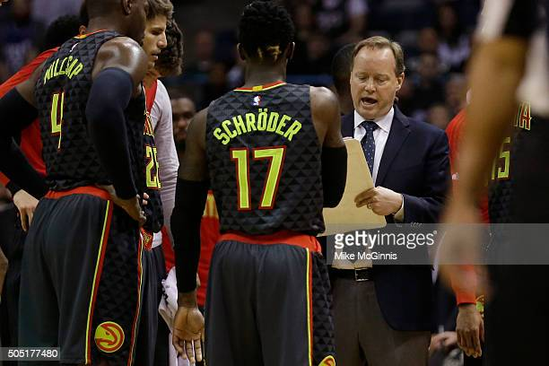Head Coach Mike Budenholzer of the Atlanta Hawks draws up a play during a time out in the second quarter against the Milwaukee Bucks at BMO Harris...