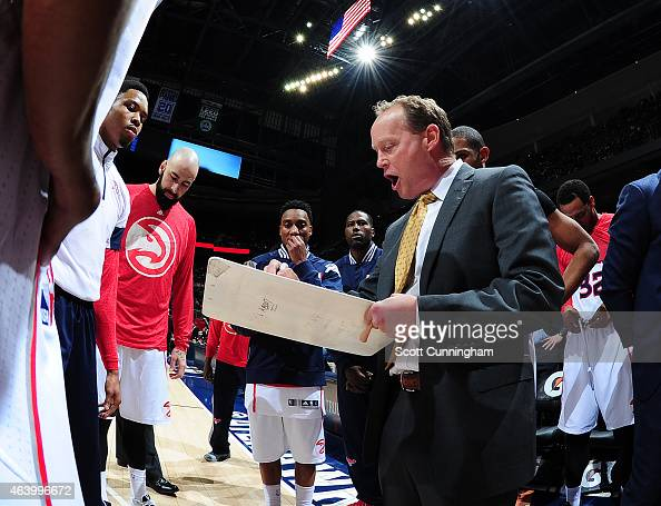 Head Coach Mike Budenholzer of the Atlanta Hawks draws up a play against the Toronto Raptors on February 20 2015 at Philips Arena in Atlanta Georgia...