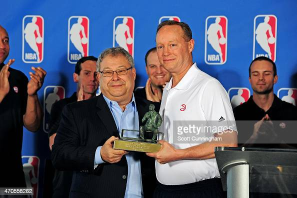 Head Coach Mike Budenholzer of the Atlanta Hawks is awarded the NBA Coach Of The Year trophy by Hawks CEO Steve Koonin during a press conference on...