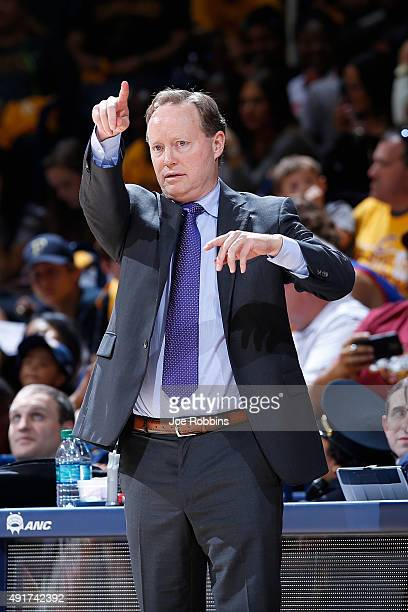 Head coach Mike Budenholzer of the Atlanta Hawks looks on against the Cleveland Cavaliers in the second half of a preseason game at Cintas Center on...