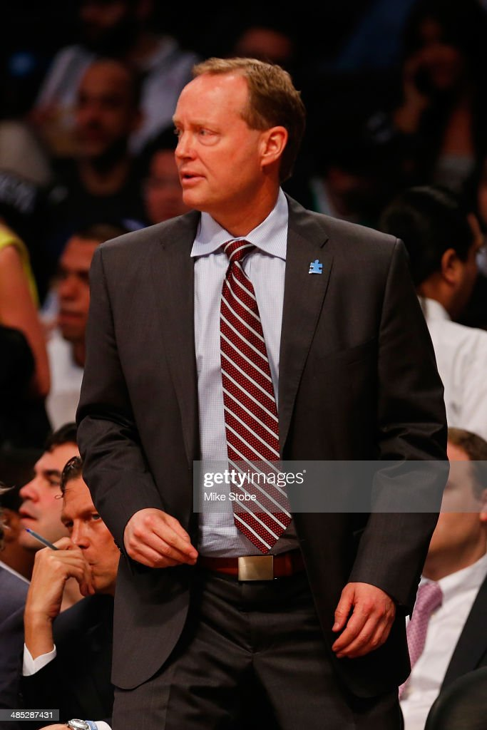Head Coach Mike Budenholzer of the Atlanta Hawks looks on from the bench against the Atlanta Hawks at Barclays Center on April 11, 2014 in New York City.