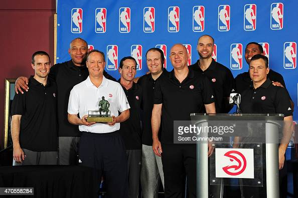 Head Coach Mike Budenholzer of the Atlanta Hawks poses for a photograph with his Assistant Coaches after being awarded the NBA Coach Of The Year...