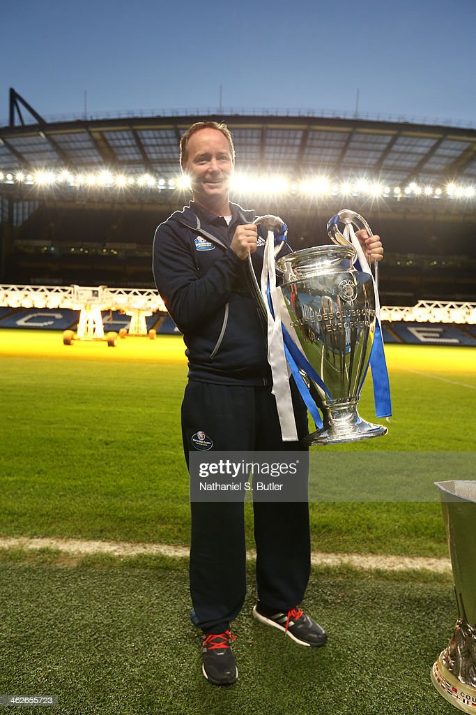 Head Coach Mike Budenholzer of the Atlanta Hawks poses with the Euroleague Cup as part of the 2014 Global Games on January 14, 2014 at Chelsea Football Club in London, England.