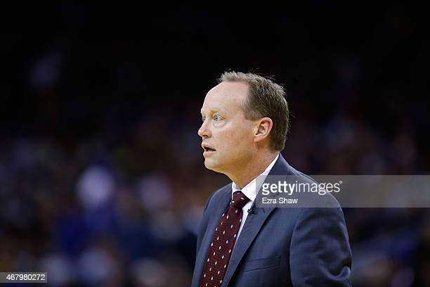 Head coach Mike Budenholzer of the Atlanta Hawks stands on the sidelines during their game against the Golden State Warriors at ORACLE Arena on March...