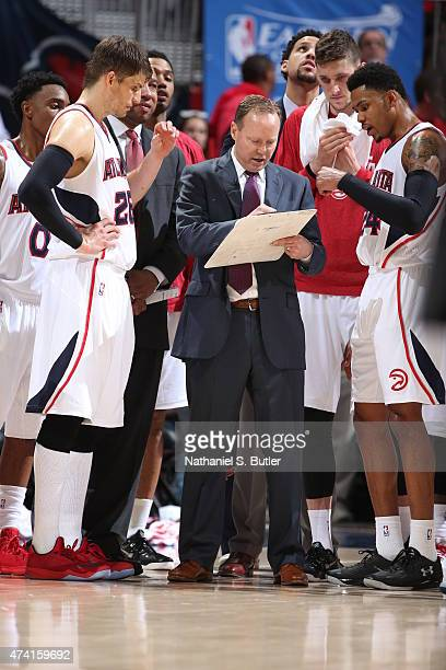 Head coach Mike Budenholzer of the Atlanta Hawks talks with his team in Game One of the Eastern Conference Finals against the Cleveland Cavaliers...
