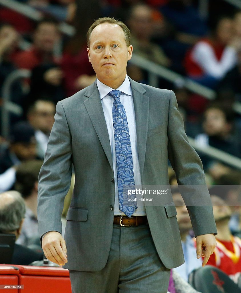 Head coach Mike Budenholzer of the Atlanta Hawks watches the action during their game against the Houston Rockets at the Toyota Center on December 20...