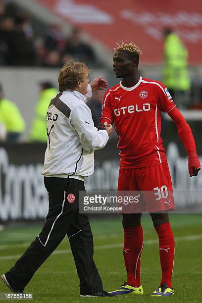 Head coach Mike Bueskens Mike Bueskens celebrates with Aristide Bance of Duesseldorf after the Second Bundesliga match between Fortuna Duesseldorf...