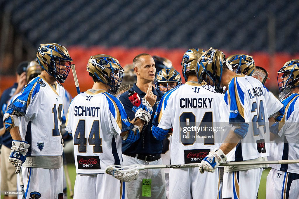 Head coach Mike Cerino of the Charlotte Hounds has a talk with his team, including Brett Schmidt #44 and Joe Cinosky #84 during a timeout during a Major League Lacrosse game against the Denver Outlaws at Sports Authority Field at Mile High on June 29, 2013 in Denver, Colorado. The Outlaws beat the Hounds 17-11 and improved to 9-0 on the season.