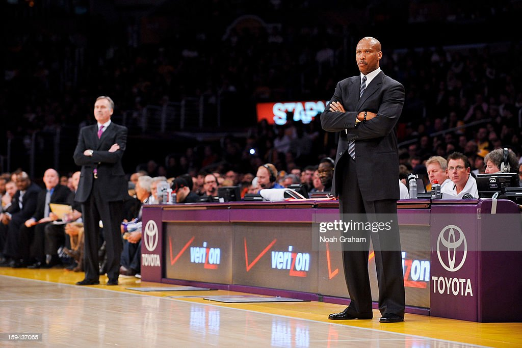 Head coach Mike D'Antoni of the Los Angeles Lakers and head coach Byron Scott of the Cleveland Cavaliers look on during their game at Staples Center on January 13, 2013 in Los Angeles, California.