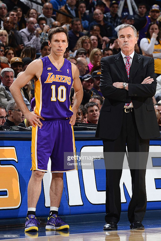 Head Coach Mike D'Antoni of the Los Angeles Lakers and Steve Nash #10 look on during their game against the Denver Nuggets on February 25, 2013 at the Pepsi Center in Denver, Colorado.