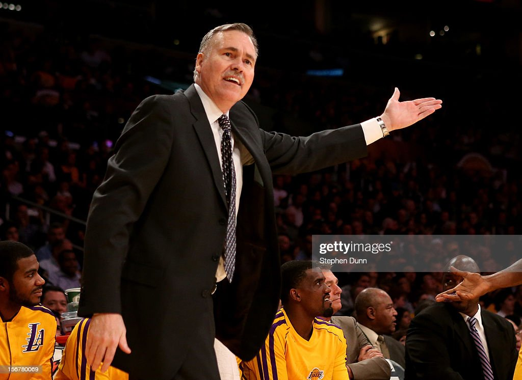 Head coach Mike D'Antoni of the Los Angeles Lakers complains to a referee in the game against the Brooklyn Nets at Staples Center on November 20, 2012 in Los Angeles, California. The Lakers won 95-90.
