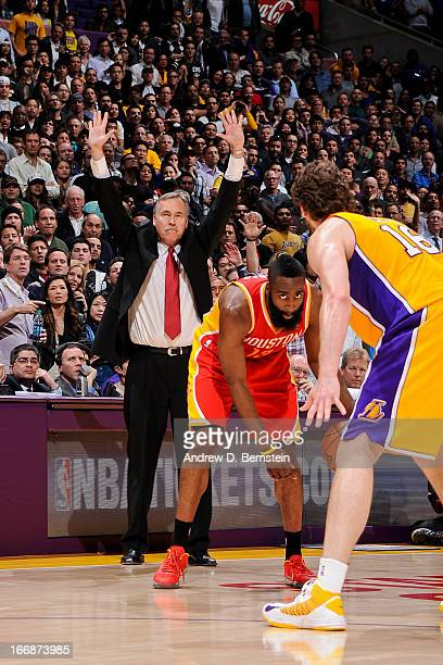 Head Coach Mike D'Antoni of the Los Angeles Lakers directs his team as James Harden of the Houston Rockets controls the ball against Pau Gasol of the...