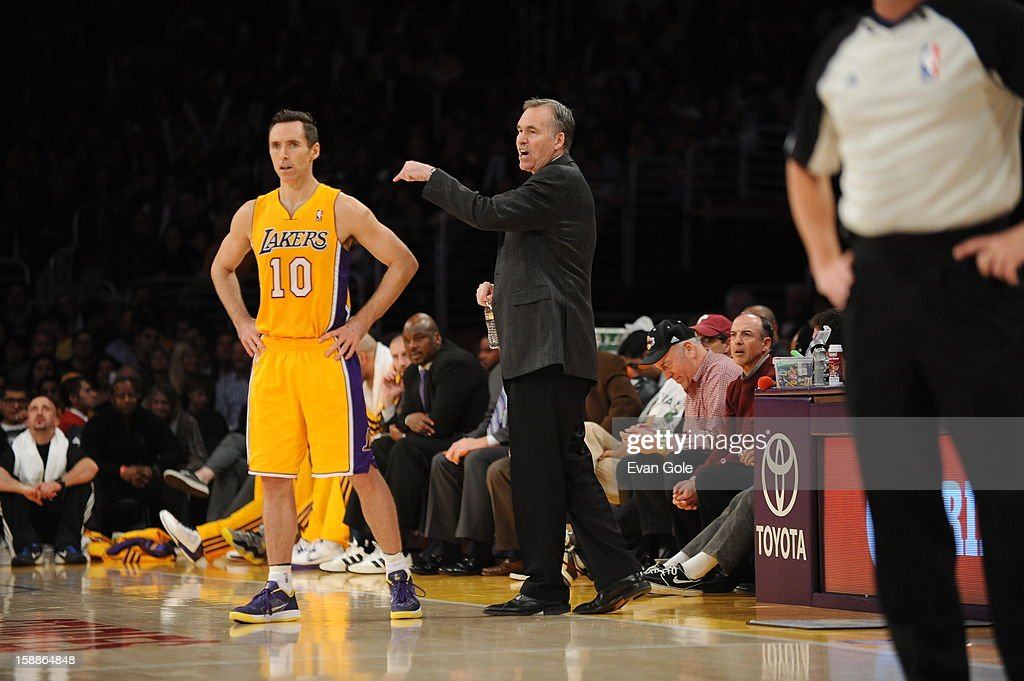 Head coach Mike D'Antoni of the Los Angeles Lakers directs his team while Steve Nash #10 looks on against the Philadelphia 76ers at Staples Center on January 1, 2013 in Los Angeles, California.