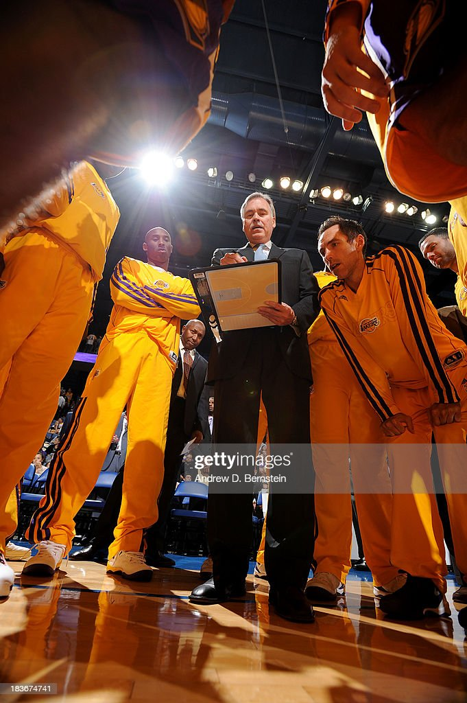 Head Coach <a gi-track='captionPersonalityLinkClicked' href=/galleries/search?phrase=Mike+D%27Antoni&family=editorial&specificpeople=203175 ng-click='$event.stopPropagation()'>Mike D'Antoni</a> of the Los Angeles Lakers draws a play prior to the game against the Denver Nuggets at Citizens Business Bank Arena on October 8, 2013 in Ontario, California.