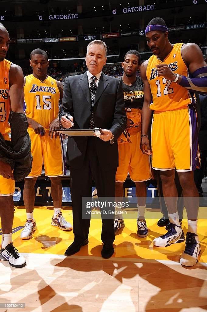 Head coach Mike D'Antoni of the Los Angeles Lakers draws up a play for his team during a timeout against the Brooklyn Nets at Staples Center on November 20, 2012 in Los Angeles, California.