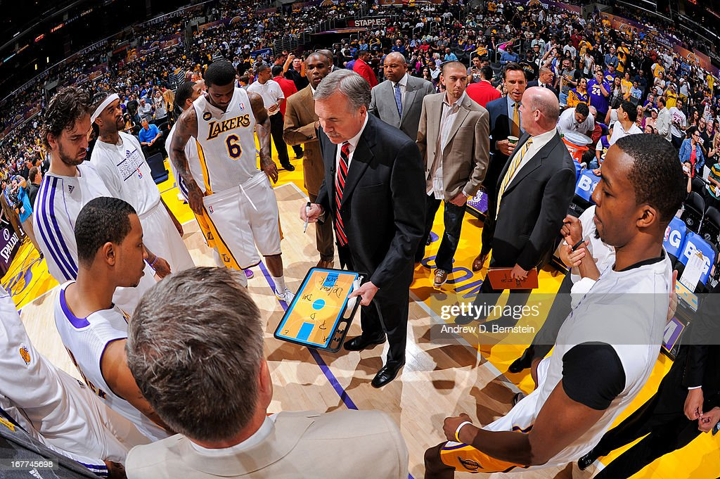 Head Coach Mike D'Antoni of the Los Angeles Lakers draws up plays for his team against the San Antonio Spurs in Game Four of the Western Conference Quarterfinals during the 2013 NBA Playoffs at Staples Center on April 28, 2013 in Los Angeles, California.