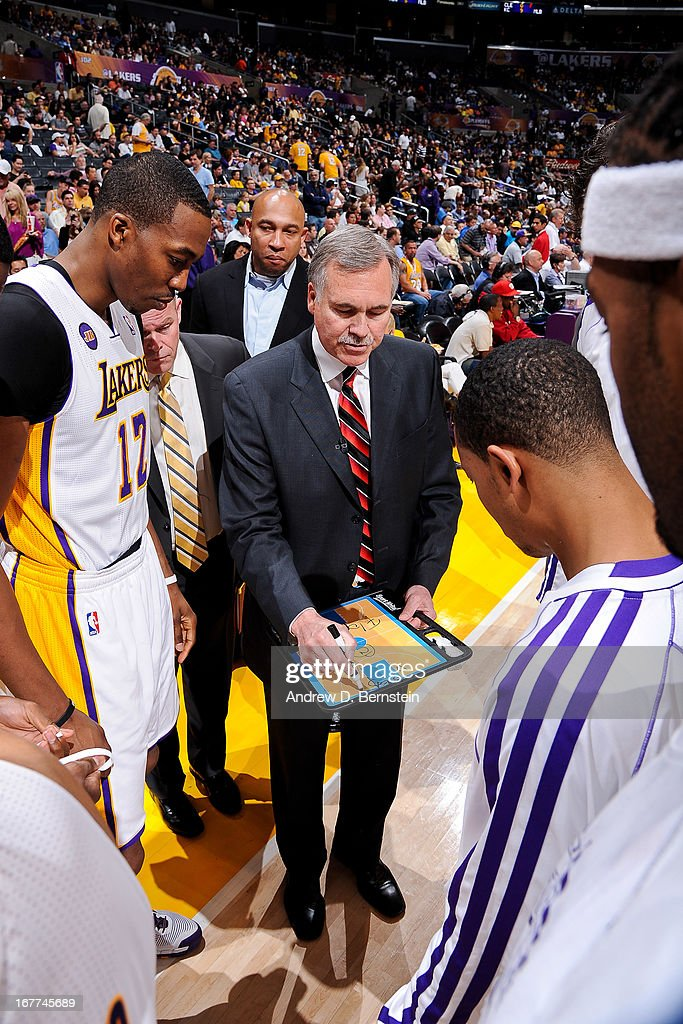 Head Coach Mike D'Antoni of the Los Angeles Lakers draws up plays with Dwight Howard #12 while playing against the San Antonio Spurs in Game Four of the Western Conference Quarterfinals during the 2013 NBA Playoffs at Staples Center on April 28, 2013 in Los Angeles, California.