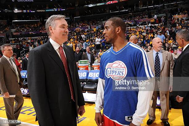 Head coach Mike D'Antoni of the Los Angeles Lakers is greeted by Chris Paul of the Los Angeles Clippers at halftime of their game at Staples Center...