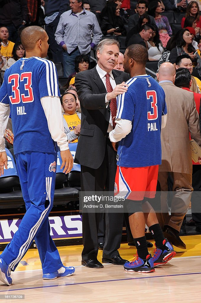 Head coach Mike D'Antoni of the Los Angeles Lakers is greeted by Chris Paul #3 of the Los Angeles Clippers at halftime of their game at Staples Center on February 14, 2013 in Los Angeles, California.