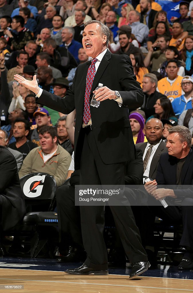 Head coach Mike D'Antoni of the Los Angeles Lakers leads his team against the Denver Nuggets at the Pepsi Center on February 25, 2013 in Denver, Colorado. The Nuggets defeated the Lakers 119-108.