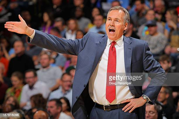 Head coach Mike D'Antoni of the Los Angeles Lakers leads his team against the Denver Nuggets at Pepsi Center on November 13 2013 in Denver Colorado...