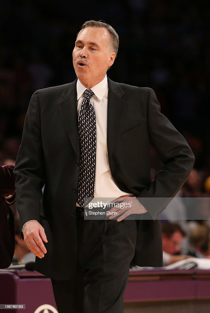 Head coach Mike D'Antoni of the Los Angeles Lakers reacts after the Lakers maintain possession in the final seconds against the Brooklyn Nets at Staples Center on November 20, 2012 in Los Angeles, California. The Lakers won 95-90.