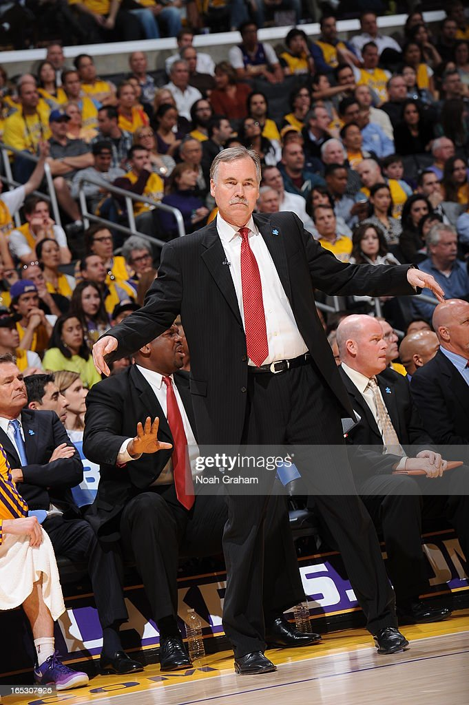 Head coach Mike D'Antoni of the Los Angeles Lakers reacts during a game against the Dallas Mavericks at Staples Center on April 2, 2013 in Los Angeles, California.