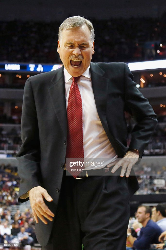 Head coach <a gi-track='captionPersonalityLinkClicked' href=/galleries/search?phrase=Mike+D%27Antoni&family=editorial&specificpeople=203175 ng-click='$event.stopPropagation()'>Mike D'Antoni</a> of the Los Angeles Lakers reacts to a first half play against the Washington Wizards at Verizon Center on December 14, 2012 in Washington, DC.