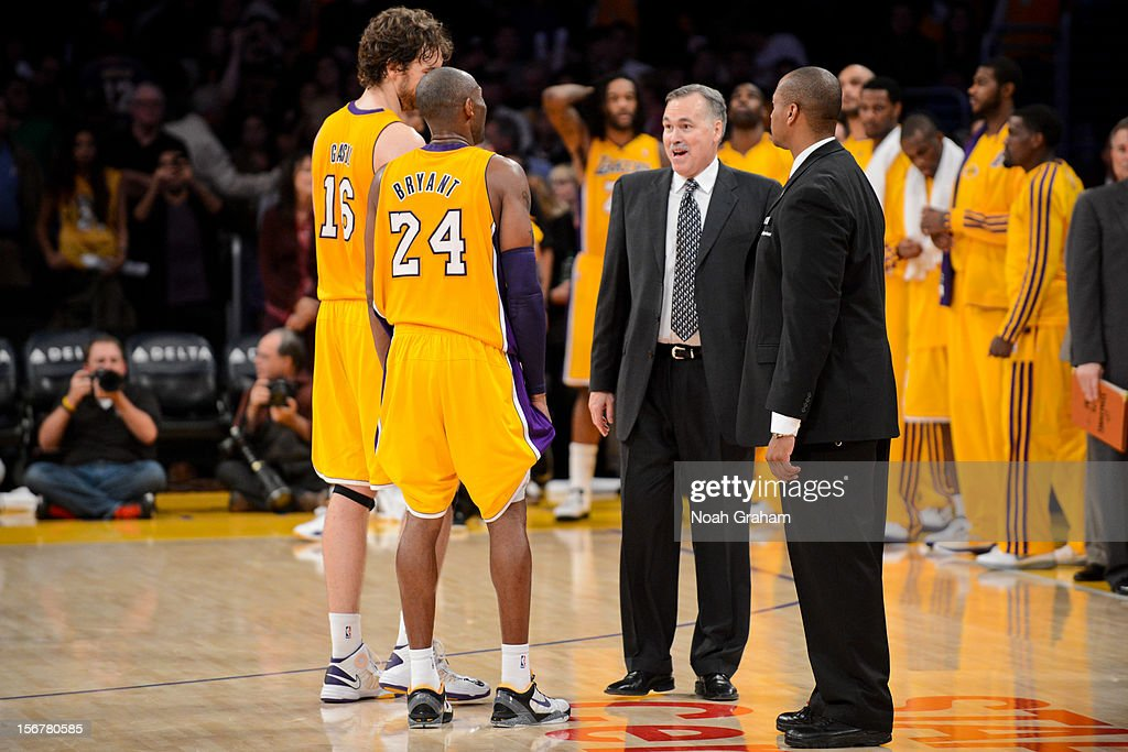 Head coach Mike D'Antoni of the Los Angeles Lakers speaks to Kobe Bryant #24 and Pau Gasol #16 during a break in action against the Brooklyn Nets at Staples Center on November 20, 2012 in Los Angeles, California.
