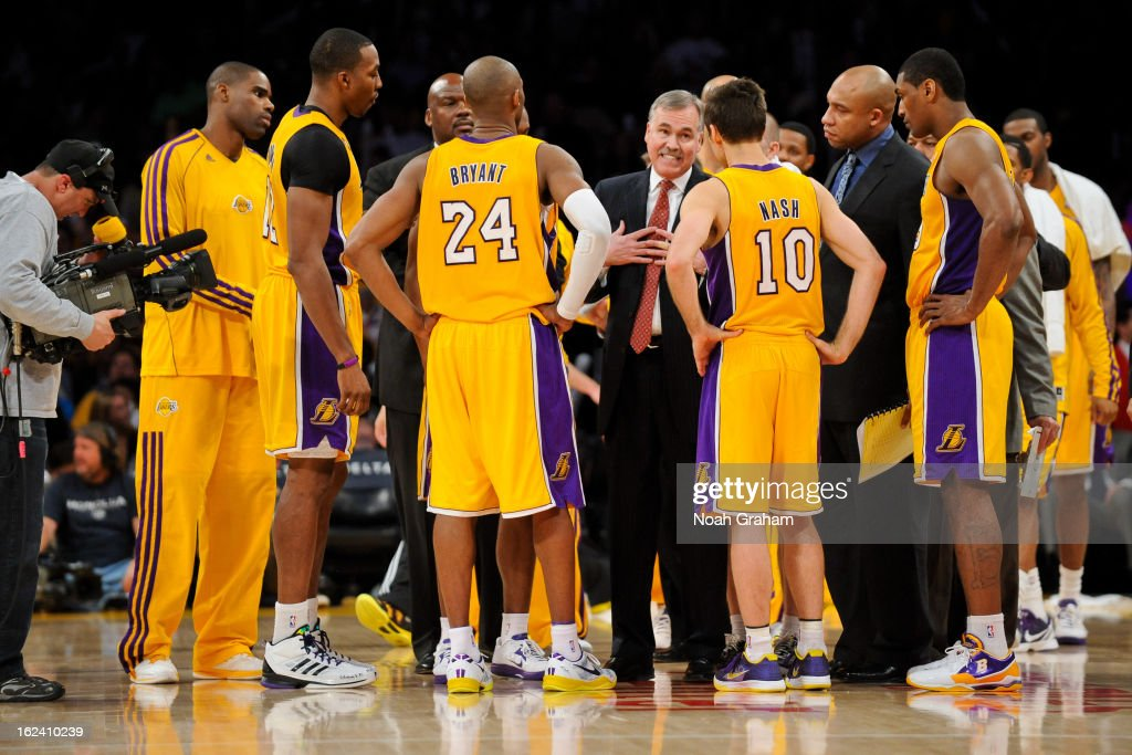 Head Coach <a gi-track='captionPersonalityLinkClicked' href=/galleries/search?phrase=Mike+D%27Antoni&family=editorial&specificpeople=203175 ng-click='$event.stopPropagation()'>Mike D'Antoni</a> of the Los Angeles Lakers speaks with players <a gi-track='captionPersonalityLinkClicked' href=/galleries/search?phrase=Dwight+Howard&family=editorial&specificpeople=201570 ng-click='$event.stopPropagation()'>Dwight Howard</a> #12, <a gi-track='captionPersonalityLinkClicked' href=/galleries/search?phrase=Kobe+Bryant&family=editorial&specificpeople=201466 ng-click='$event.stopPropagation()'>Kobe Bryant</a> #24 and <a gi-track='captionPersonalityLinkClicked' href=/galleries/search?phrase=Steve+Nash&family=editorial&specificpeople=201513 ng-click='$event.stopPropagation()'>Steve Nash</a> #10 during a timeout in a game against the Portland Trail Blazers at Staples Center on February 22, 2013 in Los Angeles, California.