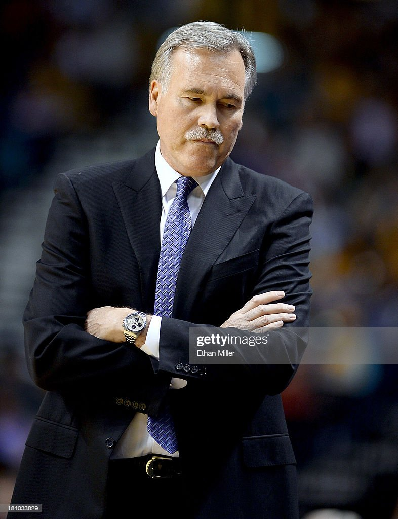 Head coach Mike D'Antoni of the Los Angeles Lakers stands on the court during a timeout as the team takes on the Sacramento Kings during their preseason game at the MGM Grand Garden Arena on October 10, 2013 in Las Vegas, Nevada. Sacramento won 104-86.