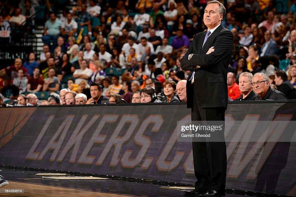 Head Coach <a gi-track='captionPersonalityLinkClicked' href=/galleries/search?phrase=Mike+D%27Antoni&family=editorial&specificpeople=203175 ng-click='$event.stopPropagation()'>Mike D'Antoni</a> of the Los Angeles Lakers stands on the sidelines against the Sacramento Kings at the MGM Grand Garden Arena on October 10, 2013 in Las Vegas, Nevada.