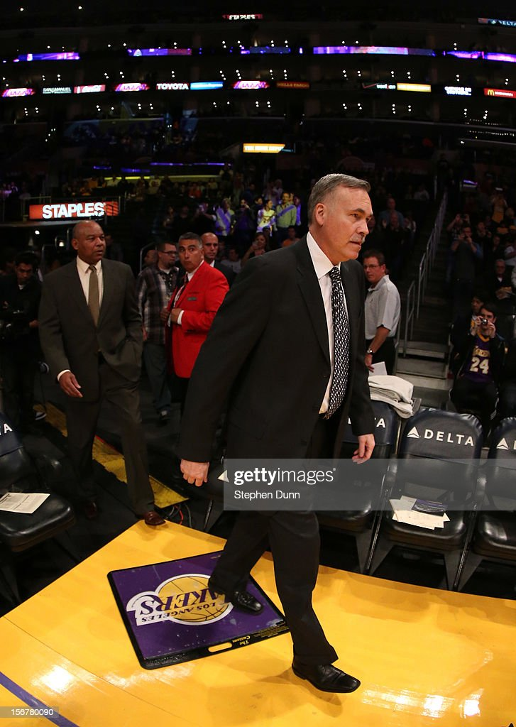 Head coach Mike D'Antoni of the Los Angeles Lakers walks onto the court for his first game as Lakers coach, against the Brooklyn Nets at Staples Center on November 20, 2012 in Los Angeles, California. The Lakers won 95-90.