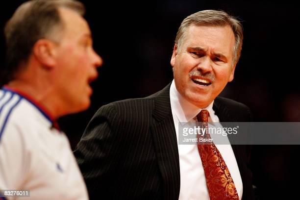 Head coach Mike D'Antoni of the New York Knicks argues with an official during a preseason game against the Philadelphia 76ersat Madison Square...
