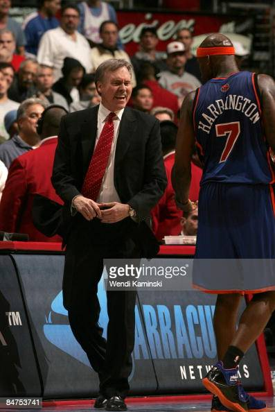 Head Coach Mike D'Antoni of the New York Knicks scolds Al Harrington for drawing a technical foul by slapping the backboard after a dunk during a...
