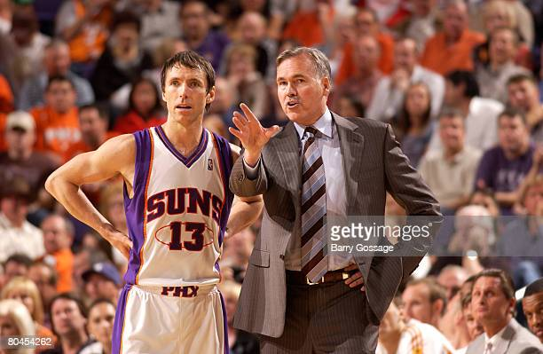 Head coach Mike D'Antoni of the Phoenix Suns talks with Steve Nash during a time out as the Suns host the Denver Nuggets in an NBA game played at US...